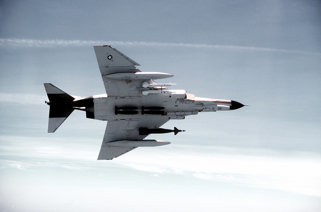 F-4E Phantom II aircraft from the 347th Tactical Fighter Wing. The aircraft is carrying an inboard 2,000-pound GBU-10 laser designator, six 500-pound Mark 82 low-drag bombs, and two inboard AIM-9J Sidewinder missiles (left side to right)
