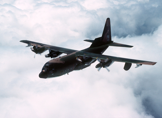 High angle left front view of an EC-130 Hercules aircraft of the 193rd Tactical Electronic Warfare Group, Pennsylvania Air National Guard, in-flight