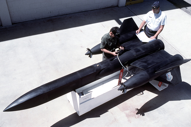 Technicians conduct a bench test on a diagnostic tow target