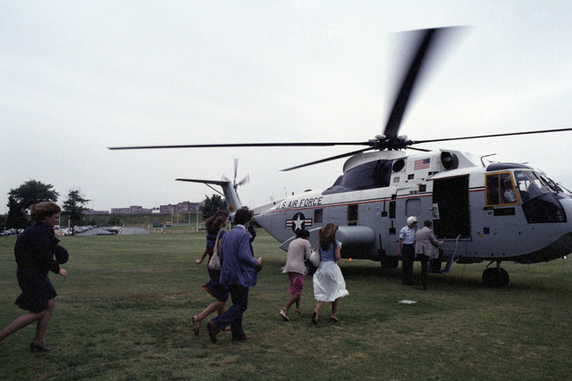 The 12 outstanding students selected from the winners of an international science fair prepare to board an SH-3 helicopter for the ride from the Pentagon to Andrews Air Force Base after their tour