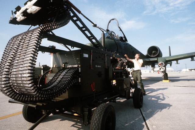AN automatic loader is moved into position for loading the 30mm nose gun on an A-10 Thunderbolt II aircraft during an operational readiness inspection at Travis Field