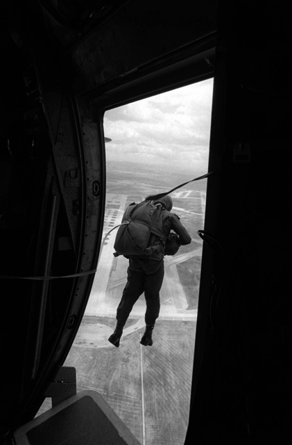 A pararescueman from the 33rd Aerospace Rescue and Recovery Squadron jumps from an HC-130 Hercules aircraft during SAREX '80