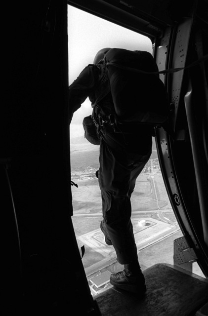 A pararescueman from the 33rd Aerospace Rescue and Recovery Squadron prepares to jump from an HC-130 Hercules aircraft during SAREX '80