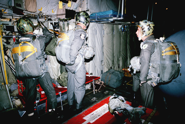 Pararescuemen assigned to the 33rd Aerospace Rescue and Recovery Squadron check over their equipment prior to a competition jump during SAREX '80