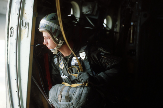 SGT Tony Hughes, 33rd Aerospace Rescue and Recovery Squadron, looks out the door of an HC-130 Hercules aircraft prior to his jump during SAREX '80