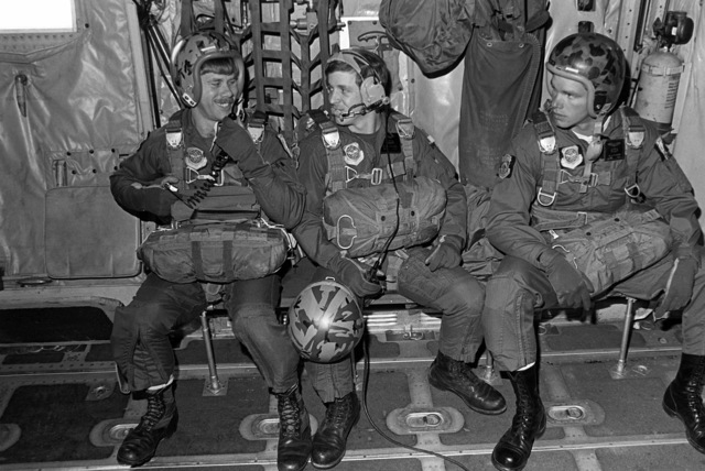 SSGT E. Beranek, SGT Tony Hughes and A1C Mark Perdue, all of the 33rd Aerospace Rescue and Recovery Squadron, wait their turn aboard an HC-130 Hercules aircraft prior to making their jump during SAREX '80