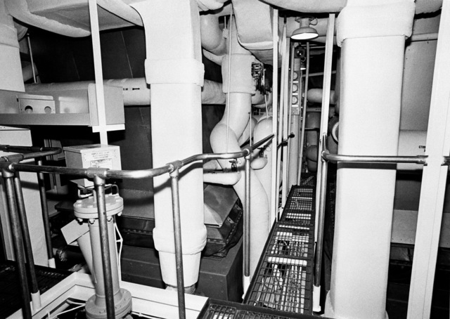 An interior view of the engine room on the guided missile frigate DUNCAN (FFG 10) at 100 percent completion