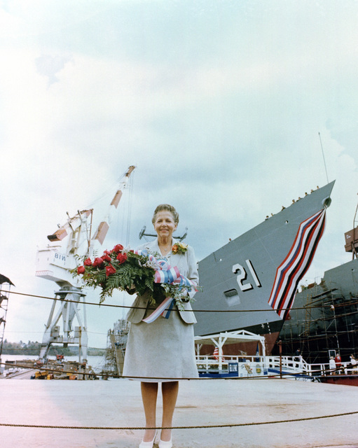 Dorothy M. Flatley, sponsor, stands in front of the Flatley prior to the start of the launching ceremony for the Oliver Hazard Perry class guided missile frigate