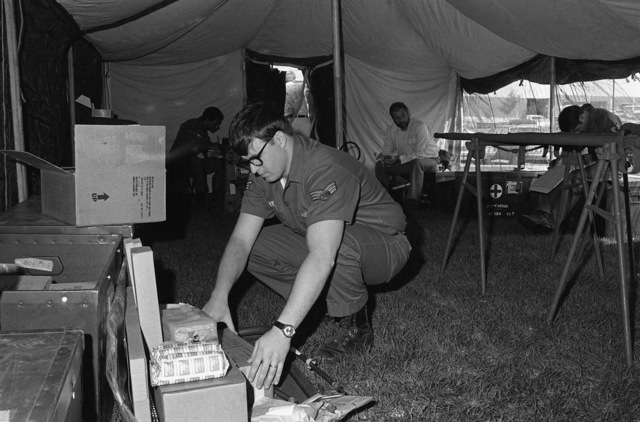 SRA David L. Bittick, an aeromedical specialist, helps to set-up the Air Transport Clinic by unpacking the medical supplies. The clinic has this type of field training once a year