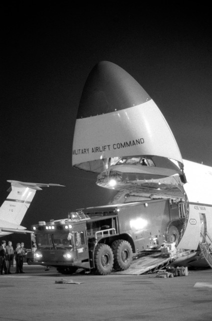 A P-15 fire truck is offloaded from a C-5 Galaxy aircraft. The P-15 provides approximately twice the fire fighting agent capacity and delivery rate of other vehicles