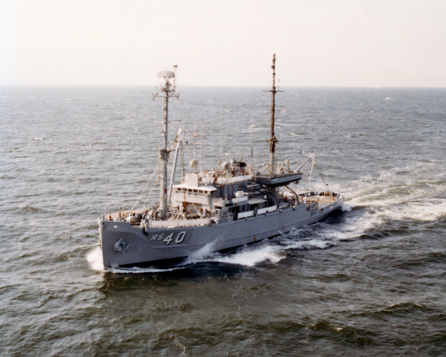 An aerial port bow view of the salvage ship USS HOIST (ARS 40) underway