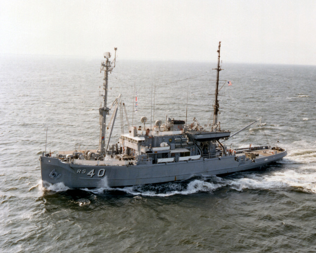 An aerial port view of the salvage ship USS HOIST (ARS-40) underway