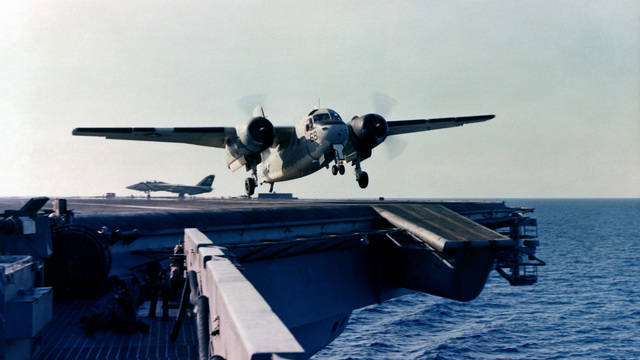 A C-1A Trader aircraft takes off from the flight deck of the aircraft carrier USS NIMITZ (CVN 68). The C-1A is a carrier on-board delivery (COD) aircraft developed to carry high priority freight and passengers to and from carriers at sea