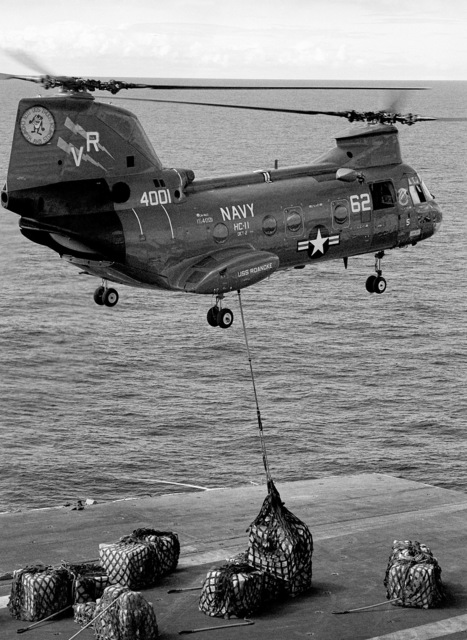 A CH-46 Sea Knight helicopter from Helicopter Combat Support Squadron (HC 11), assigned to the replenishment oiler USS ROANOKE (AOR 7), delivers supplies aboard the aircraft carrier USS CORAL SEA (CV 43). The CORAL SEA is returning to its home port at Naval Air Station Alameda, California after an Indian Ocean deployment