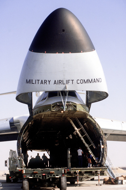 A close-up front view of a C-5A Galaxy aircraft with the nose cone up during exercise PROUD PHANTOM