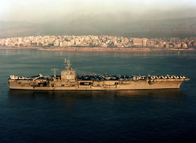 A starboard beam view of the nuclear-powered aircraft carrier USS NIMITZ (CVN 68)