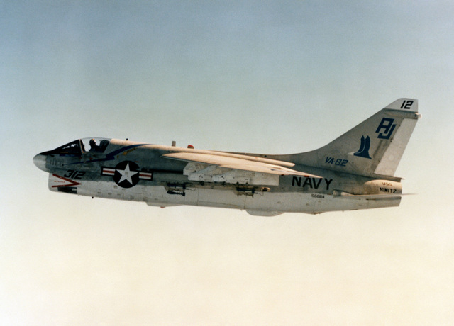 An air-to-air left side view of an A-7E Corsair II aircraft from Light Attack Squadron 82 (VA-82). The squadron is assigned to the aircraft carrier USS NIMITZ (CVN 68)