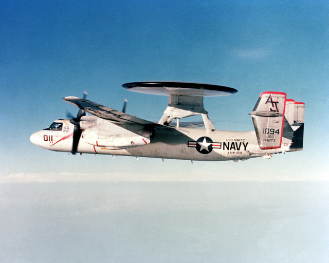 An air-to-air side view of an E-2C Hawkeye Airborne Early Warning (AEW) aircraft from Carrier AEW Squadron 124. The E-2C is assigned to the nuclear-powered aircraft carrier USS NIMITZ (CVN-68)