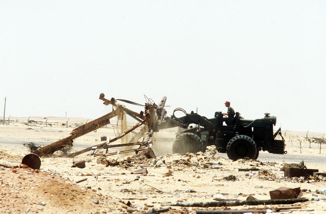 AN airman uses a bulldozer to clear away debris during exercise PROUD PHANTOM