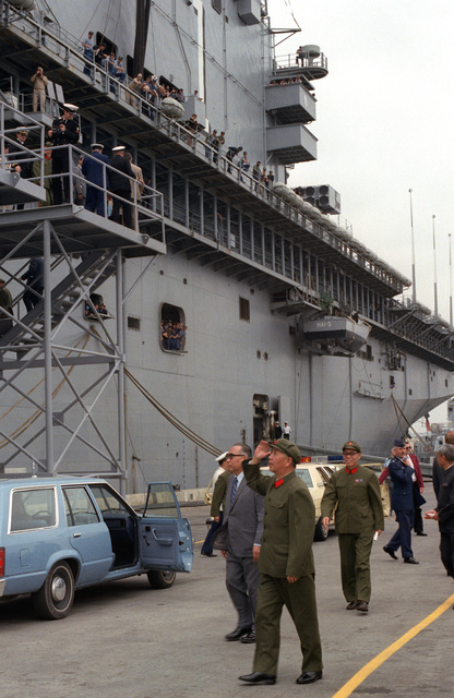 Chai Zemien, Chinese ambassador to the United States, and the delegation from the People's Republic of China prepare to leave the docks after touring the amphibious assault ship USS TARAWA (LHA-1)