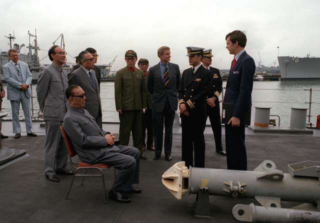 Vice Premier Geng Biao, People's Republic of China, and part of his delegation are given a briefing and a tour of the guided missile cruiser USS FOX (CG-33)