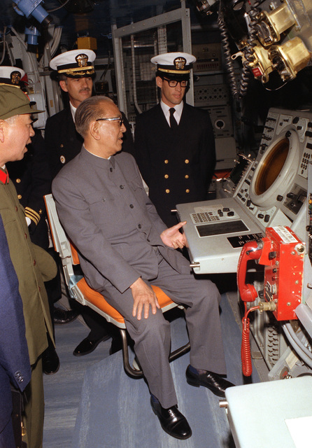 Vice Premier Geng Biao, People's Republic of China, looks at the scope of the sonar screen aboard the guided missile cruiser USS FOX (CG-33)