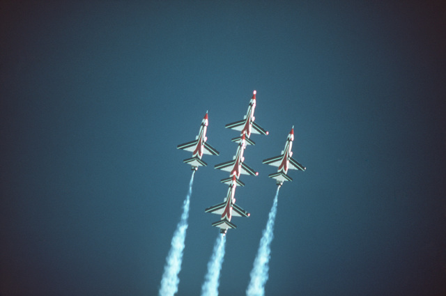 Four Air Force Thunderbird Air Demonstration Squadron T-38 Talon aircraft fly in a diamond formation during an air show
