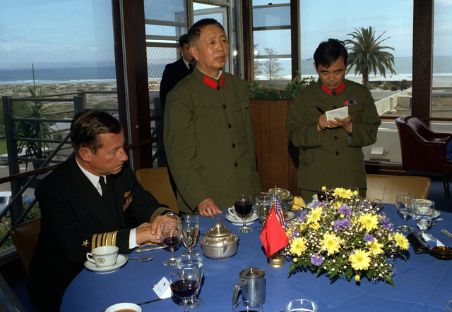 Members of the delegation from China and their hosts, members of the U.S. Navy, dine formally at the Hotel Del Coronado prior to their departure