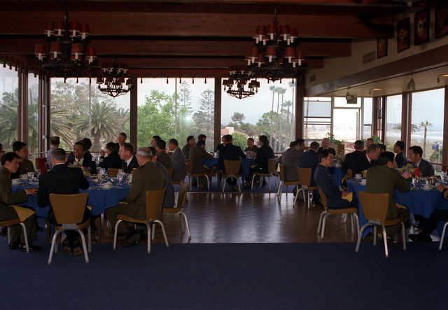 Members of the delegation from China and their hosts, the U.S. Navy, dine at the Hotel Del Coronado prior to their departure