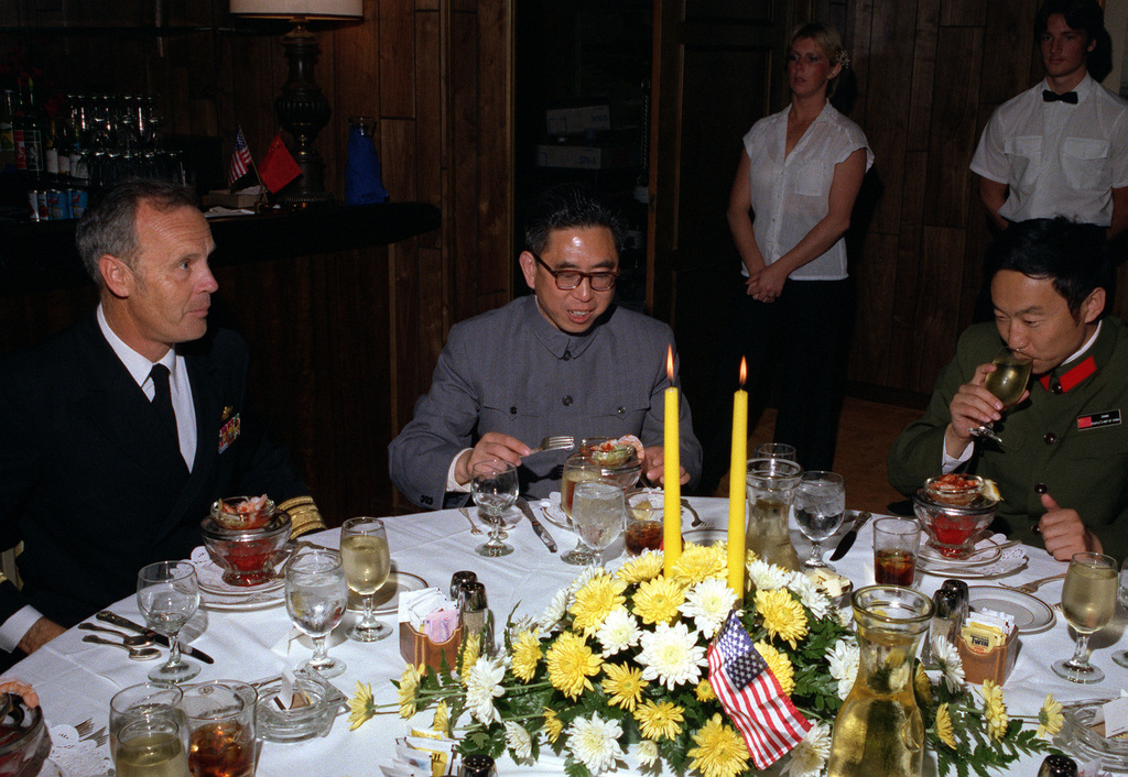 Members of the delegation from China enjoy cocktails with their host, flag officers of the U.S. Navy. The delegates are touring various naval installations