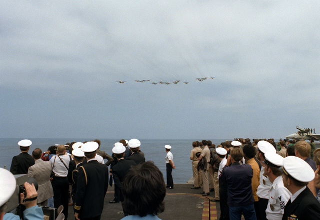Vice Premier Gen Biao of China and his delegation along with the military personnel aboard the aircraft carrier USS RANGER (CV-61) watch an air and sea demonstration