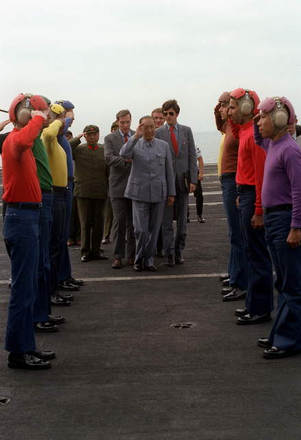 Vice Premier Geng Biao of China is given a tour of the aircraft carrier USS RANGER (CV-61)