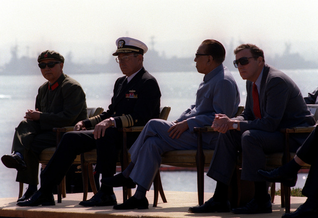 Vice Premier Geng Biao of China talks with VADM Lee Baggett Jr. as they watch an aerial demonstration