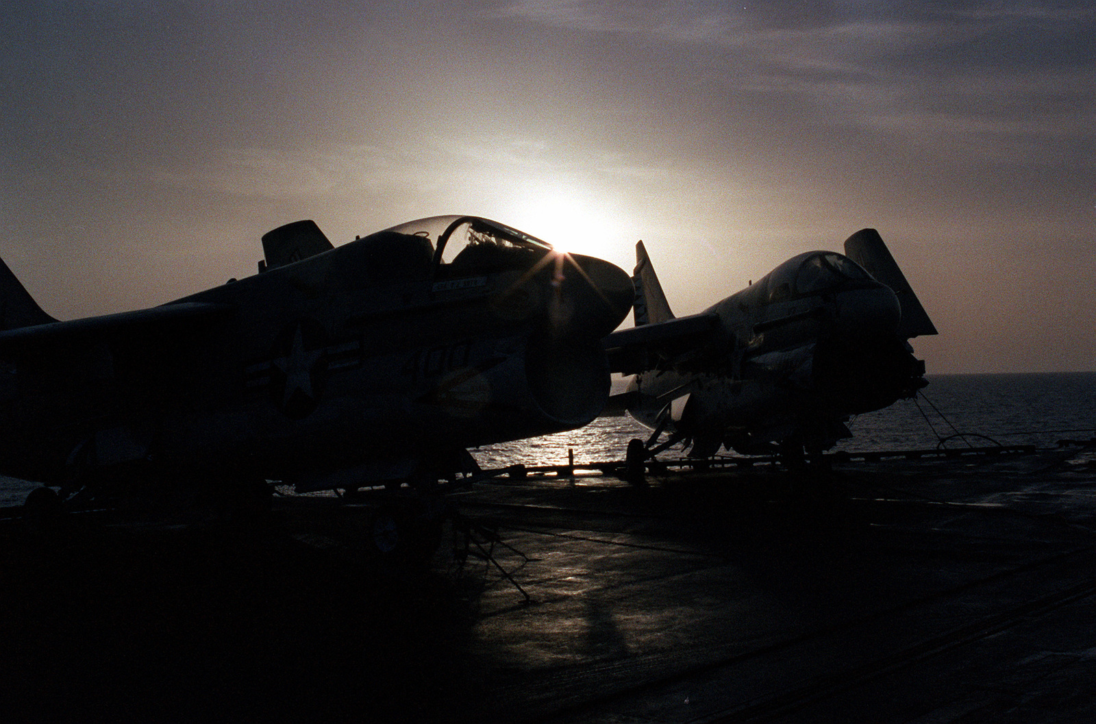 Right front view of two A-7 Corsair II attack aircraft parked aboard the aircraft carrier USS CORAL SEA (CV-43)