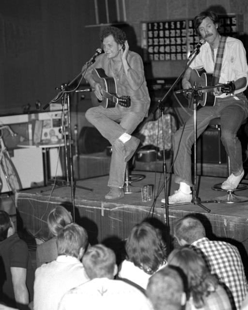 Harry and Tom Chapin in concert before a crowd at the base