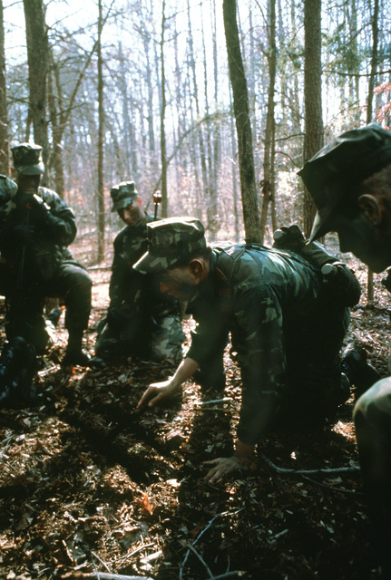 CPL C. Candelario, squad leader from the Marine detachment of the USS INDEPENDENCE (CV-62), instructs his men on combat tactics at the Marine Corps Development and Education Command