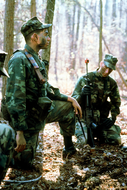 CPL C. Candelario squad leader from the Marine detachment of the USS INDEPENDENCE (CV-62), instructs his men on combat tactics at the Marine Corps Development and Education Command