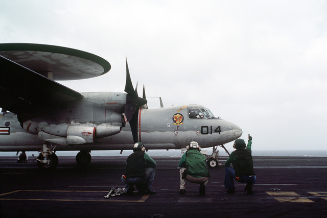 A right side view of an E-2A Hawkeye aircraft preparing for launch