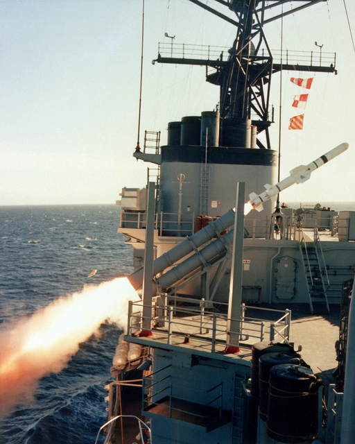 A side view of an RGM-84 Harpoon missile immediately after being fired from a canister launcher aboard the destroyer USS FLETCHER (DD-992)