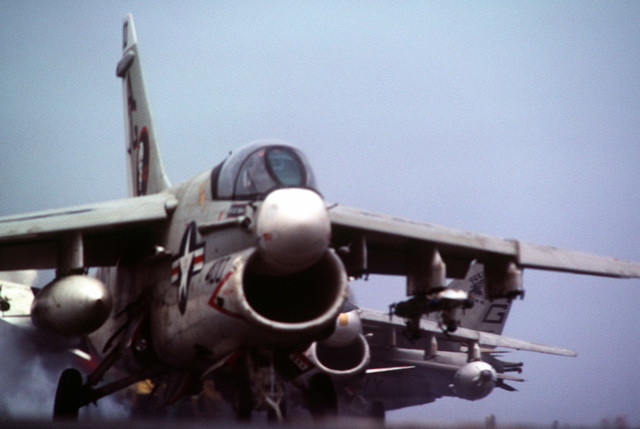 An A-7 Corsair II aircraft starts down the starboard catapult during a takeoff from the flight deck of the aircraft carrier USS CONSTELLATION (CV 64)