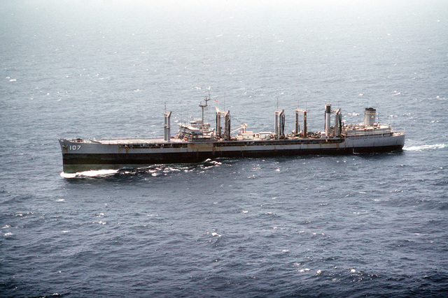 An aerial port beam view of the oiler USNS PASSUMPSIC (T-AO-107) underway