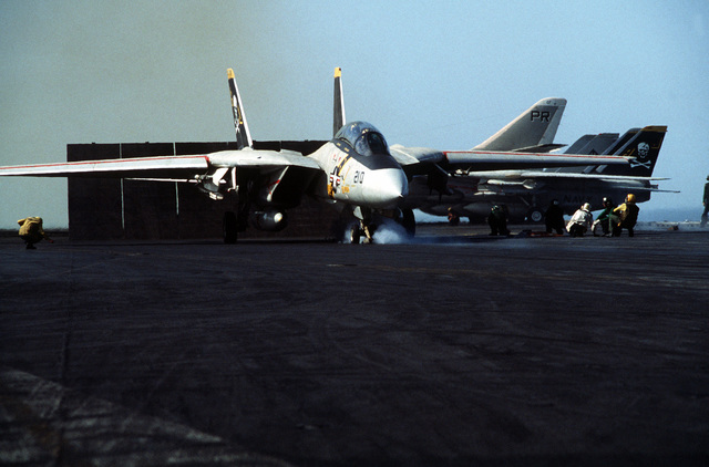 An F-14 Tomcat aircraft is in position for takeoff from the port catapult of the aircraft carrier USS CONSTELLATION (CV 64)