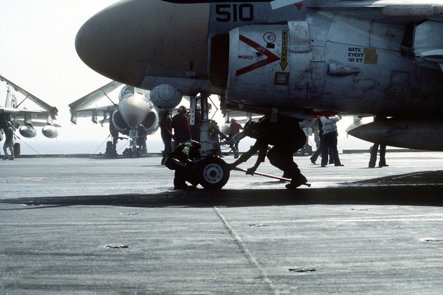 Flight deck crewmen prepare an A-6 Intruder aircraft for flight aboard the nuclear-powered aircraft carrier USS DWIGHT D. EISENHOWER (CVN-69)