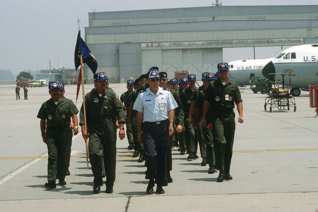 Members of the 63rd Military Airlift Wing march in formation on the flight line upon returning from Exercise VOLANT RODEO '80