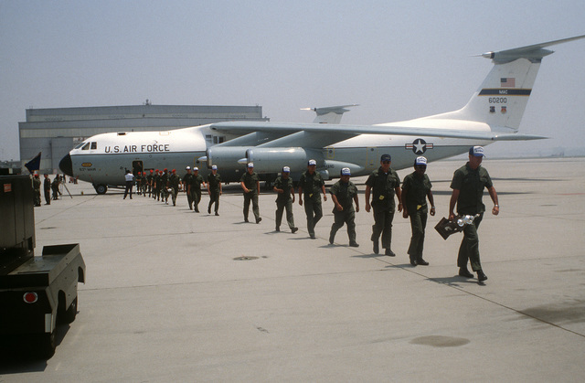 Personnel of the 63rd Military Airlift Command exit a C-141 Starlifter aircraft upon returning from Exercise VOLANT RODEO '80