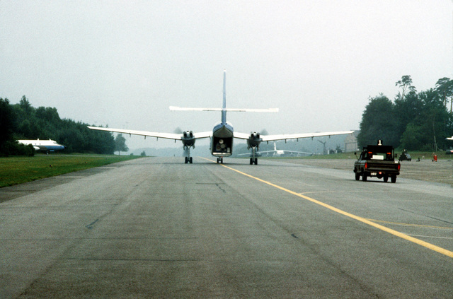 Rear view if a C-7 Caribou aircraft on the runway ready for take-off