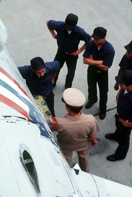 Recruits recieve training on the various exterior parts of an aircraft at the Naval Training Center, Recruit Training Command