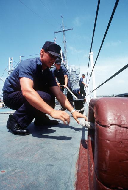 Recruits undergo basic training aboard the training destroyer escort USS RECRUIT (TDE 1) at the Naval Training Center