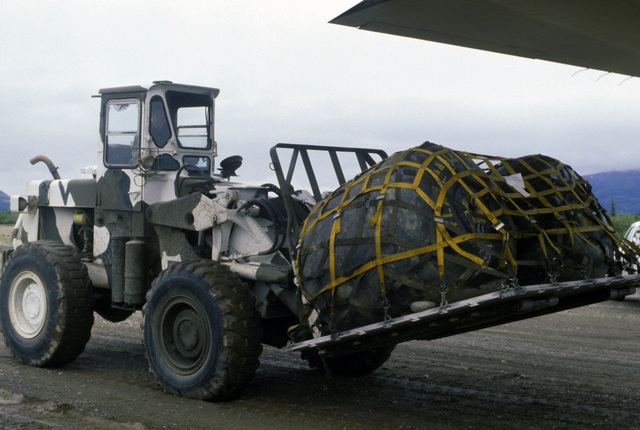 A TEREX 72-31F rough terrain fork lift is used to load a pallet of fuel bladders aboard a 17th Tactical Air Support Squadron C-130 Hercules aircraft during an Exercise