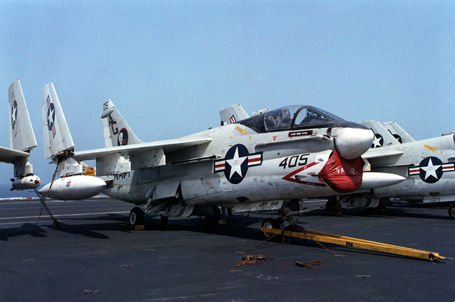 A right front view of an A-7E Corsair II aircraft, with wingtips folded, secured to the deck of the nuclear-powered aircraft carrier USS DWIGHT D. EISENHOWER (CVN-69)